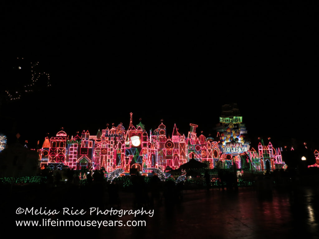It's a Small World in Disneyland with thousands of twinkling lights all lit up.