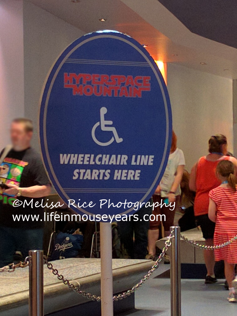 The wheelchair disability sign at the exit of Hyperspace Mountain AKA Space Mountain.