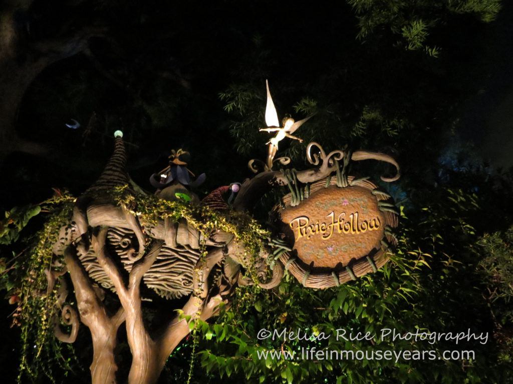 Meet Tinkerbell at Pixie Hollow in Disneyland. Entrance sign at night.