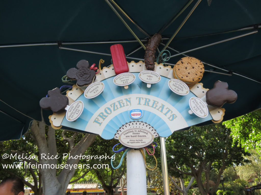 Disneyland food bucket list. Ice cream display on a ice cream cart in Disneyland.